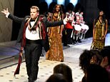 """LOS ANGELES, CA - APRIL 16:  TV personality James Corden walks the runway during the Burberry """"London in Los Angeles"""" event at Griffith Observatory on April 16, 2015 in Los Angeles, California.  (Photo by Jeff Vespa/Getty Images for Burberry)"""