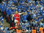 Arsenal's Alexis Sanchez celebrates after scoring his sides second goal during the English FA Cup semifinal soccer match between Arsenal and Reading at Wembley stadium in London, Saturday, April 18, 2015. (AP Photo/Alastair Grant)