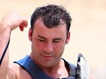 EXCLUSIVE: Retired boxer Joe Calzaghe and girlfriend Lucy are pictured at Mullins in Barbados. The two enjoyed a jet ski ride and a swim in the ocean before the rain poured. That didn't ruin their time at the beach at the two cuddled on one bed, sipped banks beer and exchanged plenty of kisses. Mandatory credit: PRIMADONNA/GEMAIRA/Splash News