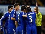 LONDON, ENGLAND - JANUARY 10:  Chelsea players surround referee Roger East during the Barclays Premier League match between Chelsea and Newcastle United at Stamford Bridge on January 10, 2015 in London, England.  (Photo by Richard Heathcote/Getty Images)