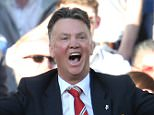 Manchester United manager Louis van Gaal and his assistant Ryan Giggs complain to the referee