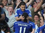 A TV camera gets a close-up of the goalscorer as Hazard celebrates with Didier Drogba in front of a section of home fans at Stamford Bridge