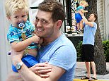 16.APRIL.2015 - MIAMI BEACH - USA *** EXCLUSIVE ALL ROUND PICTURES *** CANADIAN SINGER AND LADIES FAVOURITE MICHAEL BUBLE GOES FOR LUNCH AT JOE'S STONE CRAB WITH SON NOAH AND A FAMILY FRIEND. WHILE HE WAS OUT A FAN RECOGNISED HIM AND THEY TOOK A COUPLE OF PICS TOGETHER. BYLINE MUST READ : XPOSUREPHOTOS.COM ***UK CLIENTS - PICTURES CONTAINING CHILDREN PLEASE PIXELATE FACE PRIOR TO PUBLICATION *** **UK CLIENTS MUST CALL PRIOR TO TV OR ONLINE USAGE PLEASE TELEPHONE  44 208 344 2007**