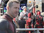 """Picture Shows: General View, GV  April 17, 2015\n \n Actor Ryan Reynolds takes a break from filming """"Deadpool"""" and unmasks to speak with city dignitaries, including the Mayor of Vancouver, Gregor Robertson, in Vancouver, Canada.\n \n Non-Exclusive\n UK RIGHTS ONLY\n \n Pictures by : FameFlynet UK © 2015\n Tel : +44 (0)20 3551 5049\n Email : info@fameflynet.uk.com"""