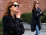 """New York, NY - Julia Roberts makes a gesture to a random person as she crosses the street to head to Cafe Cluny.  Julia met with a unknown person for presumably a meeting while getting some down time from filming her latest film """"Money Monster"""", co-starring George Clooney and directed by Jodie Foster.\nAKM-GSI          April 17, 2015\nTo License These Photos, Please Contact :\nSteve Ginsburg\n(310) 505-8447\n(323) 423-9397\nsteve@akmgsi.com\nsales@akmgsi.com\nor\nMaria Buda\n(917) 242-1505\nmbuda@akmgsi.com\nginsburgspalyinc@gmail.com"""