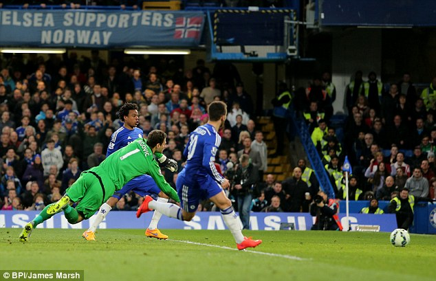 Loic Remy finishes to put Chelsea back in front after a mistake by Stoke City keeper Begovic