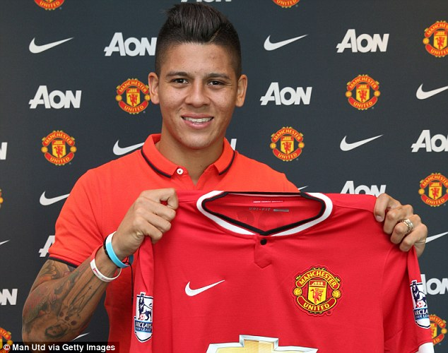 Rojo, the £200,000-a-week Manchester United defender who signed for £16m, poses after joining the Reds