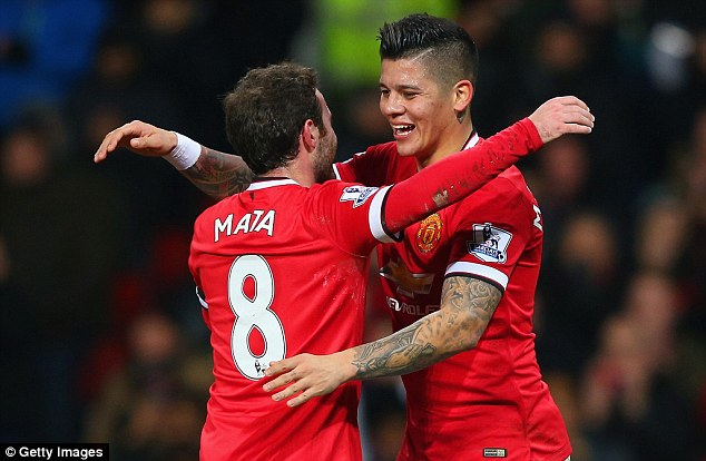 Rojo hugs Juan Mata during Manchester United's FA Cup tie with Cambridge in February