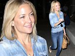 Kate Hudson arrived at LAX in blue, with her hair down and her sunglasses tucked into her shirt.  The movie star smiled for photos, on Saturday, April 18, 2015  X17online.com