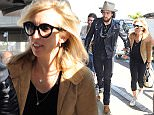 19.APRIL.2015 - LOS ANGELES - USA DIRECTOR SAM TAYLOR-JOHNSON AND HUSBAND ACTOR AARON TAYLOR JOHNSON WERE SPOTTED AT LAX AIRPORT MAKING THEY WAY THROUGH THE CROWDED TERMINAL.   BYLINE MUST READ : XPOSUREPHOTOS.COM *AVAILABLE FOR UK SALE ONLY* ***UK CLIENTS - PICTURES CONTAINING CHILDREN PLEASE PIXELATE FACE PRIOR TO PUBLICATION *** *UK CLIENTS MUST CALL PRIOR TO TV OR ONLINE USAGE PLEASE TELEPHONE 0208 344 2007*