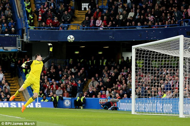 Thibaut Courtois watches on as he is unable to stop Adam's shot from hitting the back of the net for 1-1