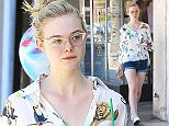 Picture Shows: Elle Fanning  April 18, 2015    'Maleficent' actress Elle Fanning enjoys an iced coffee while out and about in Studio City, California.     Elle, who recently celebrated her 17th birthday, was rocking a patterned shirt featuring various wild animals.    Exclusive - All Round  UK RIGHTS ONLY    Pictures by : FameFlynet UK © 2015  Tel : +44 (0)20 3551 5049  Email : info@fameflynet.uk.com
