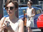 Lily Collins Stops By a Juice Bar in West Hollywood\n\nPictured: Lily Collins\nRef: SPL1002994  180415  \nPicture by: Photographer Group / Splash News\n\nSplash News and Pictures\nLos Angeles: 310-821-2666\nNew York: 212-619-2666\nLondon: 870-934-2666\nphotodesk@splashnews.com\n