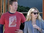 SANTA MONICA, CA - OCTOBER 25: Gwyneth Paltrow and Chris Martin chat outside Draper Consulting Group, before crossing the street to get their car on October 25, 2012 in Santa Monica, California.  PHOTOGRAPH BY AKM-GSI / Barcroft Media  UK Office, London. T +44 845 370 2233 W www.barcroftmedia.com  USA Office, New York City. T +1 212 796 2458 W www.barcroftusa.com  Indian Office, Delhi. T +91 11 4053 2429 W www.barcroftindia.com      SANTA MONICA, CA - OCTOBER 25: Gwyneth Paltrow and Chris Martin chat outside Draper Consulting Group, before crossing the street to get their car on October 25, 2012 in Santa Monica, California.  PHOTOGRAPH BY AKM-GSI / Barcroft Media  UK Office, London. T +44 845 370 2233 W www.barcroftmedia.com  USA Office, New York City. T +1 212 796 2458 W www.barcroftusa.com  Indian Office, Delhi. T +91 11 4053 2429 W www.barcroftindia.com