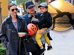 NEW YORK, NY - OCTOBER 28:  Model Miranda Kerr and Orlando Bloom with baby Flynn are seen together on Upper East Side in NYC on October 28, 2013 in New York City.  (Photo by Raymond Hall/FilmMagic)