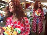 Rihanna buying munchies from Duane Reade