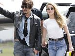 JOHNNY DEPP AND NEW WIFE AMBER HEARD ARRIVE ON THEIR PRIVATE JET AT BRISBANE AIRPORT. FOLLOWING RUMOURS OF A RIFT IN THEIR NEWLY-WEB RELATIONSHIP, JOHNNY AND AMBER PUT ON A UNITED FRONT, LOOKING HAPPY TO BE BACK DOWN UNDER! JOHNNY DEPP IS FINALLY BACK IN AUSTRALIA TO RESUME WORK ON THE NEW PIRATES OF THE CARIBBEAN FILM, IN QUEENSLAND. PRODUCTION OF THE FILM WAS SHUT DOWN FOR A MONTH DUE TO A HAND INJURY SUFFERED BY JOHNNY DEPP! 21 April 2015 ©MEDIA-MODE.COM