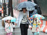 Sarah Jessica Parker walks Marion and Tabitha Broderick to school in the rain.  Pictured: Sarah Jessica Parker and  Marion and Tabitha  Broderick Ref: SPL1004902  200415   Picture by: @JDH Imagez / TJDH Imagez   Splash News and Pictures Los Angeles: 310-821-2666 New York: 212-619-2666 London: 870-934-2666 photodesk@splashnews.com