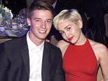 LOS ANGELES, CA - FEBRUARY 07:  Recording artist Miley Cyrus (R) and Patrick Schwarzenegger attend the Pre-GRAMMY Gala and Salute to Industry Icons honoring Martin Bandier at The Beverly Hilton Hotel on February 7, 2015 in Los Angeles, California.  (Photo by Larry Busacca/Getty Images)