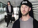 20.APRIL.2015 - LONDON - UK SUPERSTAR DJ CALVIN HARRIS WEARING A HOODED TOP AND CAP IS SPOTTED AT LONDON'S HEATHROW AIRPORT.  BYLINE MUST READ : XPOSUREPHOTOS.COM ***UK CLIENTS - PICTURES CONTAINING CHILDREN PLEASE PIXELATE FACE PRIOR TO PUBLICATION *** UK CLIENTS MUST CALL PRIOR TO TV OR ONLINE USAGE PLEASE TELEPHONE 0208 344 2007**