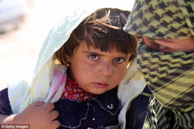 Yazidi children as young as eight have been abducted from their homes in northern Iraq, raped by ISIS fighters and forced into marriage. One child interviewed said she was 'owned' and raped by seven different men