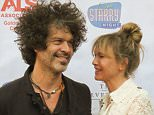 ***MANDATORY BYLINE TO READ INFPhoto.com ONLY*** Renee Zellwegger and her boyfriend Doyle Bramhall attend 'One Starry Night: From Broadway to Hollywood' gala benefiting the ALS Association Golden West Chapter in Los Angeles, CA.  Renee was attending to support her publicist Nanci Ryder who has been diagnosed with ALS.  Renee broke headlines back in October 2014, when an appearance prompted speculation that the actress had gotten plastic surgery.  The actress celebrates her 46th birthday on Saturday, April 25.  Pictured: Renee Zellweger, Doyle Bramhall Ref: SPL1004890  200415   Picture by: INFphoto.com