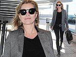 22.APRIL.2015 - LONDON - UK *** EXCLUSIVE ALL ROUND PICTURES *** SUPER MODEL KATE MOSS GAVE A SMILE TO THE CAMERA AS SHE WAS PICTURED ARRIVING AT LONDON HEATHROW AIRPORT WEARING ALL BLACK WITH A GREY BLAZER. KATE WAS CATCHING A FLIGHT OUT OF THE UK.  BYLINE MUST READ : XPOSUREPHOTOS.COM ***UK CLIENTS - PICTURES CONTAINING CHILDREN PLEASE PIXELATE FACE PRIOR TO PUBLICATION *** **UK CLIENTS MUST CALL PRIOR TO TV OR ONLINE USAGE PLEASE TELEPHONE  442083442007