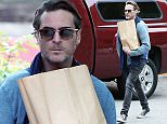 Picture Shows: Joaquin Phoenix  April 21, 2015    'Inherent Vice' star Joaquin Phoenix is seen stopping by a local market in Los Angeles, California with an older friend while his girlfriend Allie Teilz waited in the car.    Exclusive - All Round  UK RIGHTS ONLY    Pictures by : FameFlynet UK © 2015  Tel : +44 (0)20 3551 5049  Email : info@fameflynet.uk.com