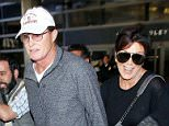 Mandatory Credit: Photo by Broadimage/REX Shutterstock (3685820ad)  Bruce Jenner and Kris Jenner  The Kardashians at LAX Los Angeles International Airport, America - 02 Apr 2014