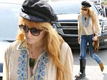 """EXCLUSIVE: Florence Welch spotted for the first time in A WALKING CAST since breaking her foot at Coachella music festival.  The Florence + the Machine singer was downcast in a stylish outfit as she ironically bared her tattoo saying """"Too Fast"""" on her foot.  The cast on Florence's right foot stops just below the knee.   The English singer/songwriter was seen in blue jeans, ankle-boots, a Peasant Blouse & a painters cap and the walking cast to accent the outfit.   Pictured: Florence Welch Ref: SPL1005801  210415   EXCLUSIVE Picture by: SplashNewsOnline.com  Splash News and Pictures Los Angeles: 310-821-2666 New York: 212-619-2666 London: 870-934-2666 photodesk@splashnews.com"""