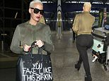 Picture Shows: Amber Rose  April 21, 2015\n \n Amber Rose arrives at Heathrow Airport in London. Amber was accompanied by assistants who carted her many suitcases for her. Amber wore a khaki green bomber jacket, black leggings and high heeled boots.\n \n Non Exclusive\n Worldwide Rights\n \n Pictures by : FameFlynet UK © 2015\n Tel : +44 (0)20 3551 5049\n Email : info@fameflynet.uk.com