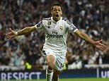 Real Madrid's Mexican forward Javier Hernandez celebrates after scoring a goal during the UEFA Champions League quarter-finals second leg football match Real Madrid CF vs Club Atletico de Madrid at the Santiago Bernabeu stadium in Madrid on April 22, 2015.     AFP PHOTO / PIERRE-PHILIPPE MARCOUPIERRE-PHILIPPE MARCOU/AFP/Getty Images