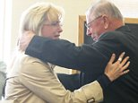 Former Iowa state legislator Henry Rayhons, right, hugs his daughter Sara Abbas after hearing a not guilty verdict in his trial Wednesday, April 22, 2015 in Garner, Iowa. Rayhons, 78, was acquitted acquitted of sexually abusing his wife who suffered from dementia, in a case that centered on questions about when a person is no longer mentally capable of consenting to sex. (Arian Schuessler/The Globe Gazette via AP)