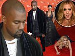 Honoree and Comedian Amy Schumer pretends to trip and fall on the floor  in front of honorees Kim Kardashian (2nd-L) and Kanye West (L) as they attend the Time 100 Gala celebrating the Time 100 issue of the Most Influential People at  The World at Jazz at Lincoln Center on April 21, 2015 in New York.  AFP PHOTO /  TIMOTHY  A. CLARYTIMOTHY A. CLARY/AFP/Getty Images