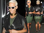 Picture Shows: Amber Rose  April 22, 2015    Amber Rose spotted as she exits the W Hotel in London, England. Amber looked great in a tight green dress and sleeveless leather jacket.    Non Exclusive  WORLDWIDE RIGHTS    Pictures by : FameFlynet UK © 2015  Tel : +44 (0)20 3551 5049  Email : info@fameflynet.uk.com