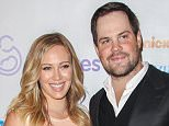 FILE - FEBRUARY 20: Actress Hilary Duff has reportedly filed for divorce from Mike Comrie after almost five years of marriage. BEVERLY HILLS, CA - DECEMBER 07: Mike Comrie and Hilary Duff arrive at the March Of Dimes' Celebration Of Babies held at the Beverly Hills Hotel on December 7, 2012 in Beverly Hills, California.  (Photo by Paul A. Hebert/Getty Images)