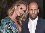 """Rosie Huntington-Whiteley, left, and Jason Statham attend Burberry's """"London in Los Angeles"""" event at the Griffith Observatory in Los Angeles, on Thursday, April 16, 2015. (Photo by Jordan Strauss/Invision/AP)"""