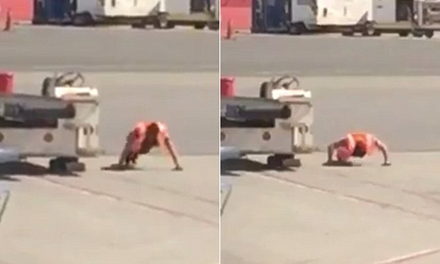 LaGuardia Airport baggage handler performs push-ups on the runway