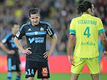 Marseille's french forward Florian Chauvin grimaces during his French League One soccer match against Nantes, in Nantes, western France, Friday, April 17, 2015. Nantes won 1-0.  (AP Photo/David Vincent)