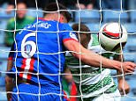 GLASGOW, SCOTLAND - APRIL 19:  Josh Meekings of Caledonian Thistle apparently handles the ball on the goal line from Leigh Griffiths of Celtic during the William Hill Scottish Cup Semi Final match between Inverness Caledonian Thistle and Celtic at Hamden Park on April 19, 2015 in Glasgow Scotland. (Photo by Mark Runnacles/Getty Images)