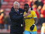 STOKE ON TRENT, ENGLAND - MARCH 21:  Manager Alan Pardew of Crystal Palace shares a joke with Yannick Bolasie of Crystal Palace during the Barclays Premier League match between Stoke City and Crystal Palace at Britannia Stadium on March 21, 2015 in Stoke on Trent, England.    Palace won the game 2-1.  (Photo by Dave Thompson/Getty Images)