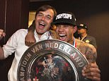 epa04711254 Coach Phillip Cocu (L) and player Memphis Depay (R) of PSV Eindhoven celebrate with the Championship trophy in the dressing room, after winning the Dutch Eredivisie soccer league in the Philips Stadium, Eindhoven, Netherlands, 18 April 2015.  EPA/OLAF KRAAK
