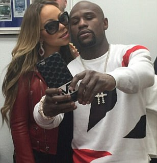 Floyd Mayweather poses with Mariah Carey as Manny Pacquiao and Jimmy Kimmel join forces to