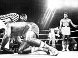 USA's George Foreman (front) is knocked to the canvas by his compatriot Muhammad Ali (back) ... Boxing - Kinshasa - Muhammad Ali v George Foreman ... 30-10-1974 ... NULL ... NULL ... Photo credit should read: DPA/Unique Reference No. 637245 ... NULL
