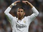 Real Madrid's Sergio Ramos gestures during the second leg quarterfinal Champions League soccer match between Real Madrid and Atletico Madrid at Santiago Bernabeu stadium in Madrid, Spain, Wednesday April 22, 2015. (AP Photo/Paul White)