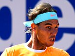 BARCELONA, SPAIN - APRIL 23:  Rafael Nadal of Spain in action against Fabio Fognini of Italy during day four of the Barcelona Open Bac Sabadell at the Real Club de Tenis Barcelona on April 23, 2015 in Barcelona, Spain. Fabio Fognini won 6-4, 7-6.  (Photo by David Ramos/Getty Images)