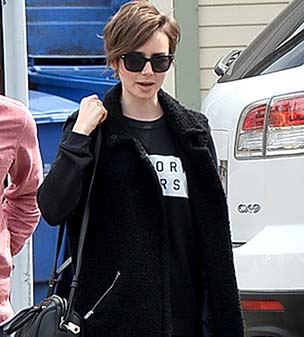 Looking the business: Lily Collins sported a  stylish ensemble as she left an office block on Tuesday