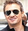 Popular guy: Jeremy Renner signed autographs for fans outside his London hotel on Wednesday