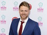 Mandatory Credit: Photo by Jonathan Hordle/REX Shutterstock (3667964q)  Brian McFadden  Tesco mum of the year awards, London, Britain - 23 Mar 2014
