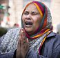 Halima Yusuf, a friend of the family of Hanad Mustafe Musse, one of the six young Somali-Americans accused of trying to sneak off to Syria to join terror organizations, cries for the boys outside the United States Courthouse in downtown St. Paul after hearings on Thursday, April 23, 2015. (Leila Navidi/Star Tribune via AP)